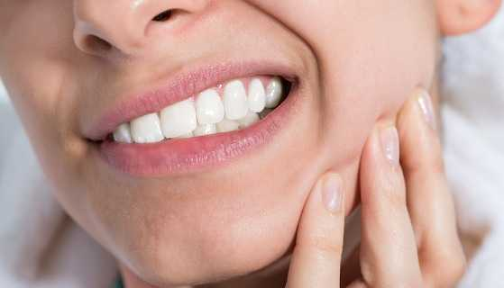 signs and symptoms of impacted tooth