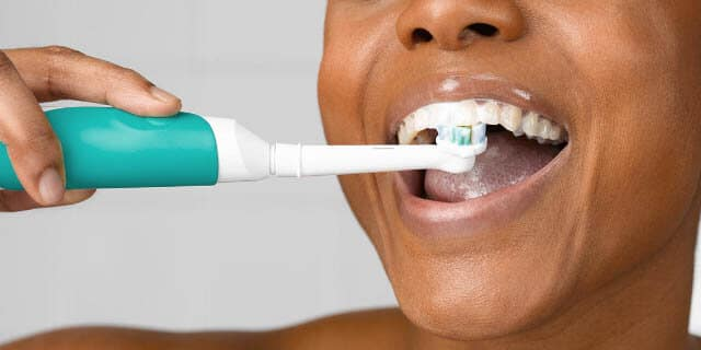 Move the electric toothbrush