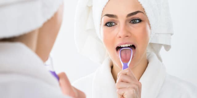 Use a Scraper to clean your Tongue